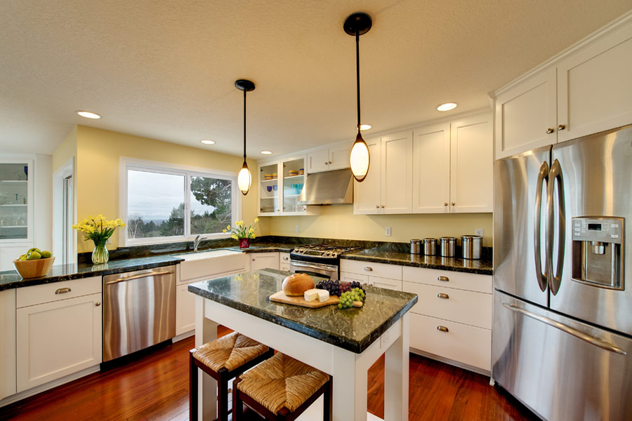 White kitchen cabinets with cherry wood floors wood floors for Cherry and white kitchen cabinets